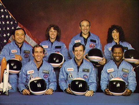 Space Shuttle Challenger crew members gather for an official portrait November 11, 1985. (Back, L-R) Mission Specialist Ellison S. Onizuka, Teacher-in-Space participant Sharon Christa McAuliffe, Payload Specialist Greg Jarvis and mission specialist Judy Resnick. (Front, L-R) Pilot Mike Smith, commander Dick Scobee and mission specialist Ron McNair.  Ms. McAuliffe was to have been the first teacher in space. She never made it there.