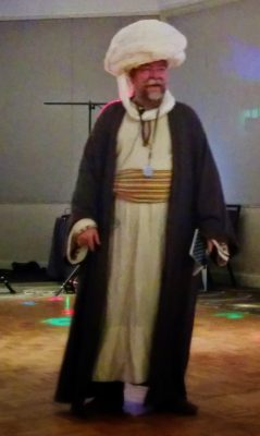 True, entertaining at the Wyrd Con 5 Opening Party (as Hodja Nasruddin)