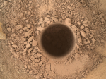 First sample drilling hole at the base of Mount Sharp (Image Credit: NASA/JPL-Caltech/MSSS)
