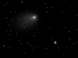 This NASA Hubble Space Telescope composite image includes the comet Siding Spring in relative position as it flew by Mars, 11:28 AM PDT October 19, 2014. (Image Credit: NASA)